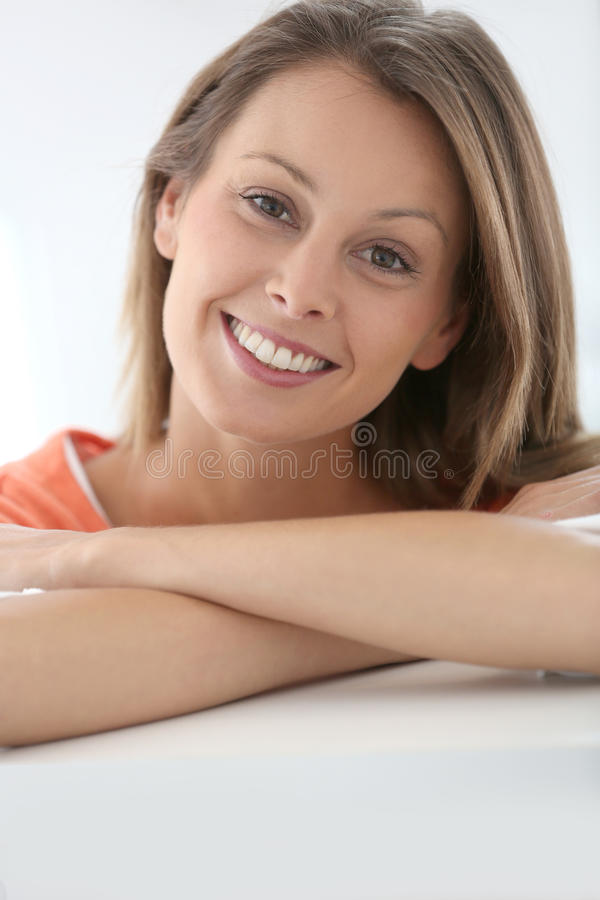 Attractive woman smiling. Portrait of attractive young woman royalty free stock photos