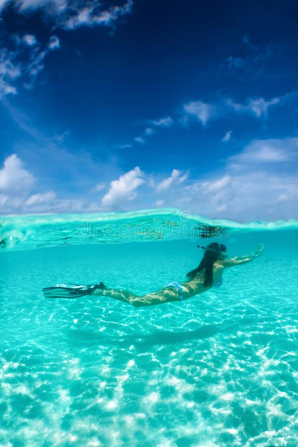Attractive woman snorkeling in tropical waters royalty free stock images