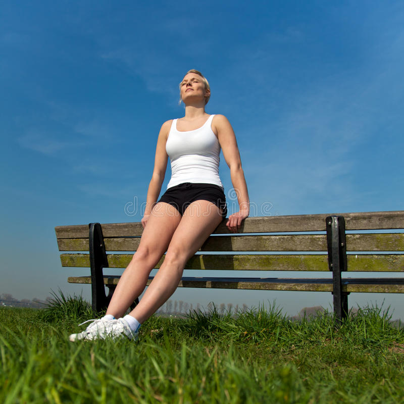 Download Attractive Woman In Sports Wear Taking A Break Stock Photo - Image: 25655058