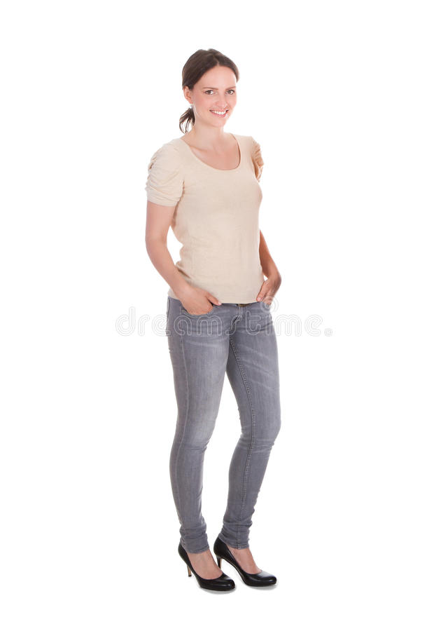 Attractive woman standing against white background royalty free stock photo