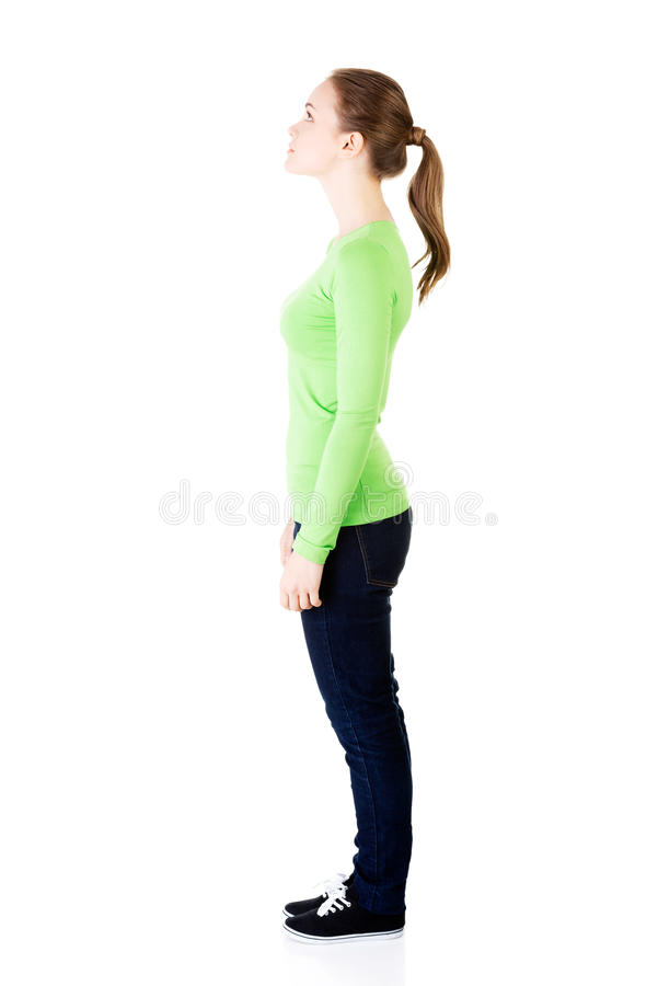 Attractive woman standing and looking up. Side view. stock images
