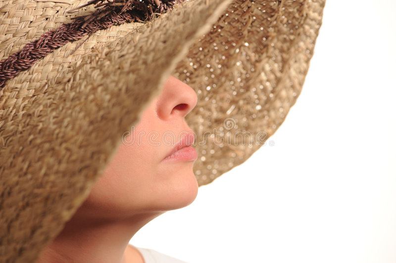 Attractive woman and straw hat stock photography