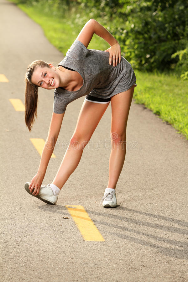 Attractive woman stretching royalty free stock photography