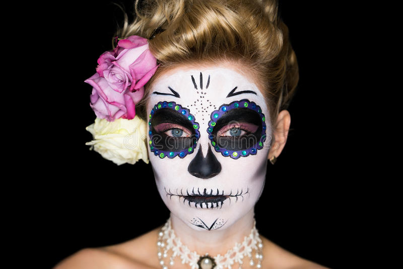 Attractive woman with sugar skull make-up. On black royalty free stock photos