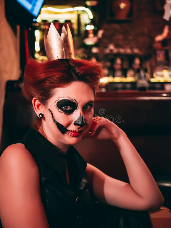 Skull make up. Attractive woman with sugar skull make up. Female in Halloween silence. Scary nights stock images