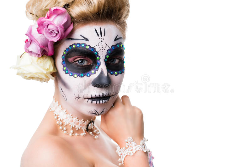 Attractive woman with sugar skull make-up. Isolated on white stock photography