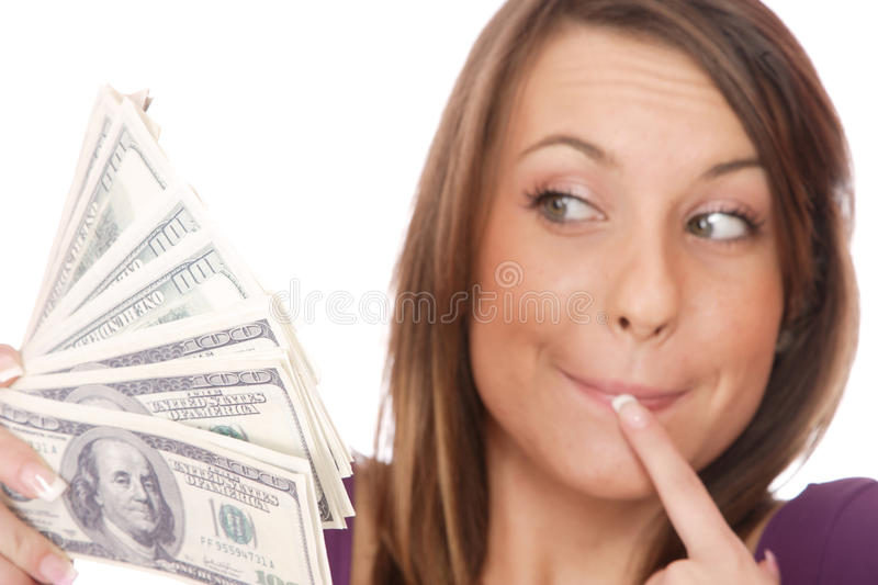 Attractive woman takes lot of 100 dollar bills royalty free stock images
