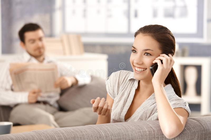 Attractive woman talking on phone smiling royalty free stock image