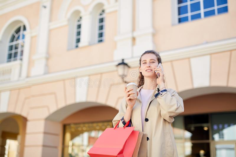 Attractive woman talking on phone royalty free stock images