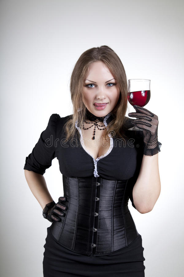 Attractive woman tasting red wine stock image