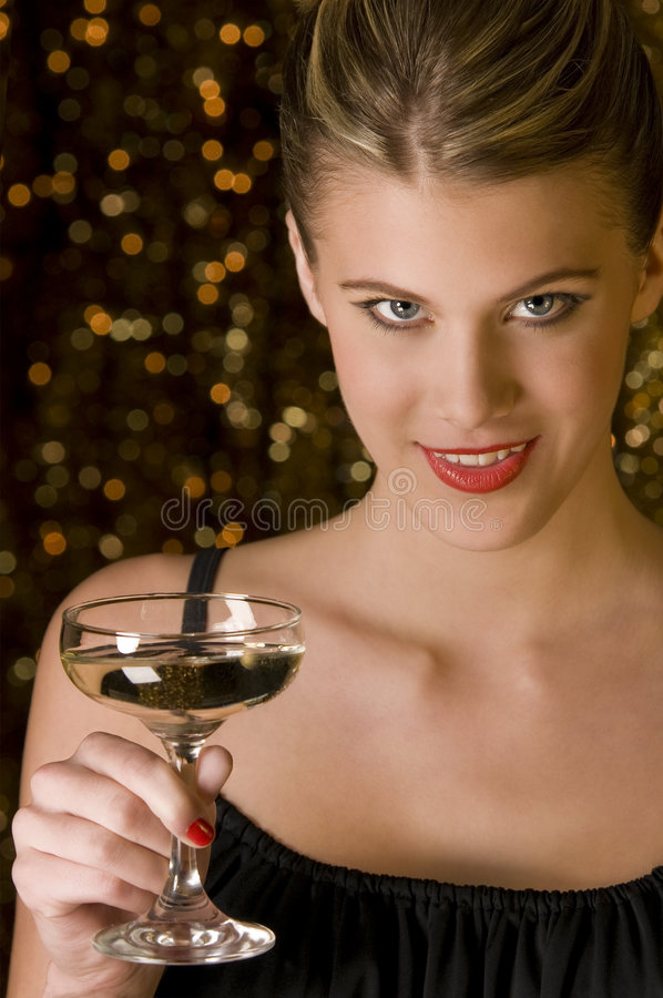 Attractive woman toasting with glass of champagne royalty free stock photo