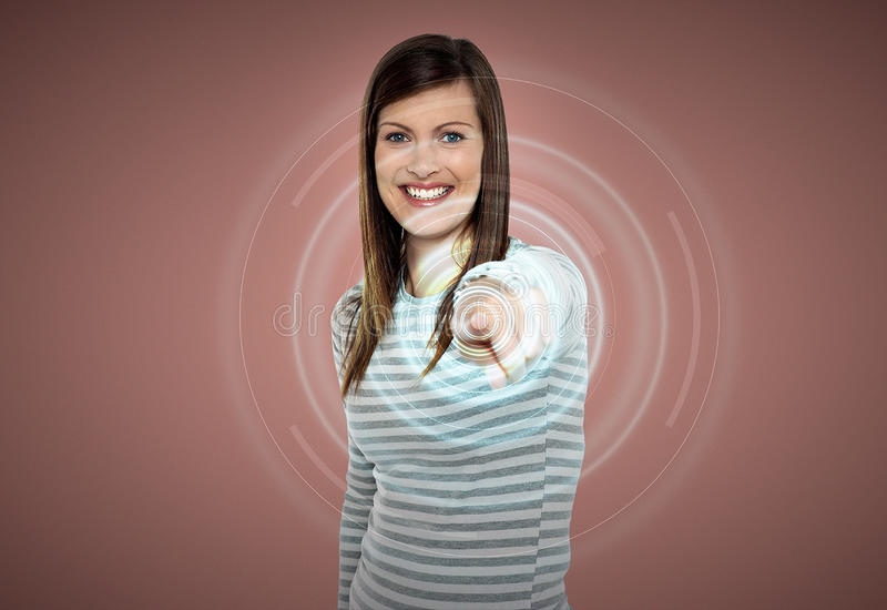 Attractive woman touching virtual screen stock image