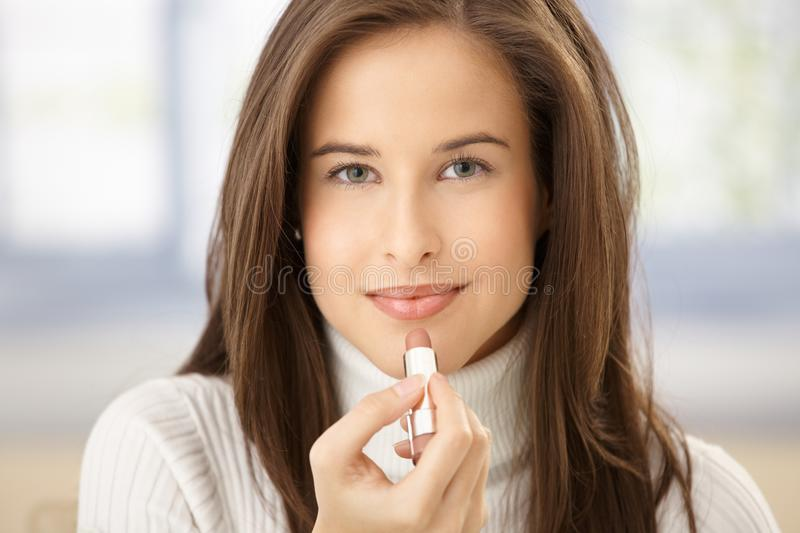 Download Attractive Woman Using Lipstick Stock Image - Image: 18760333