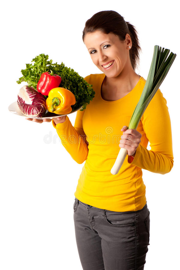 Attractive woman with vegetables royalty free stock image