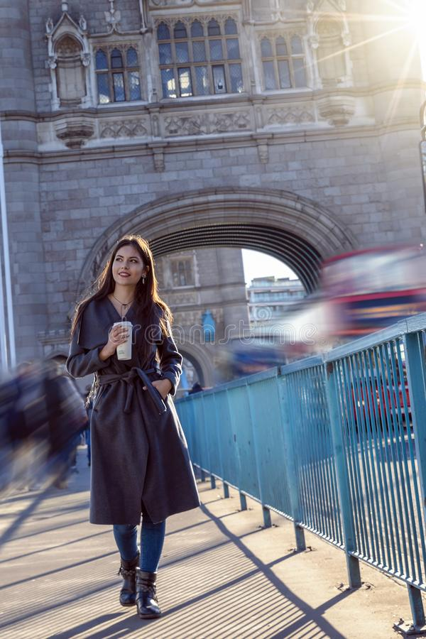 Woman walks down the streets of London, United Kingdom. Attractive woman walks down the streets of London during a sightseeing trip, United Kingdom royalty free stock images