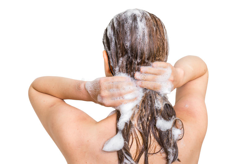 Attractive woman washing hair with shampoo in shower stock photo