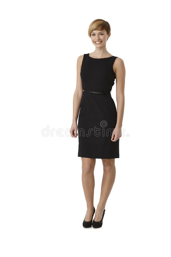 Attractive woman wearing black cocktail dress royalty free stock photos