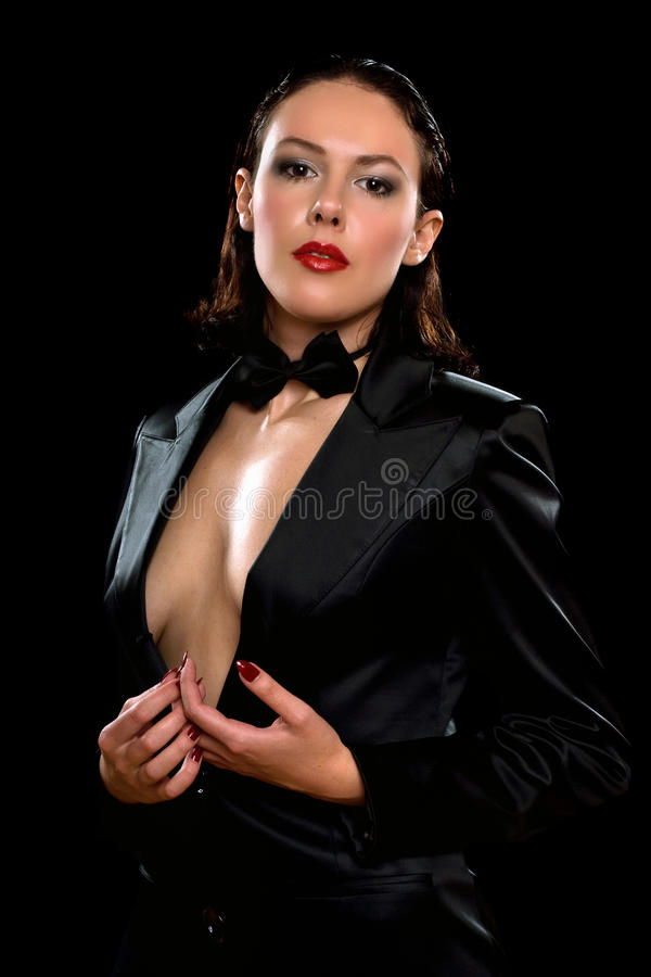 Attractive woman wearing a black suit. Attractive young woman wearing a black suit royalty free stock photo
