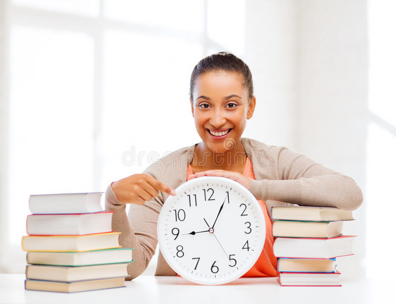 Attractive woman with white clock stock photography