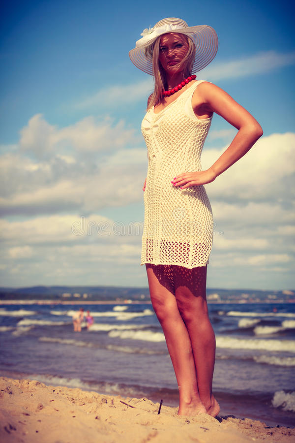 Attractive woman with white dress. stock image
