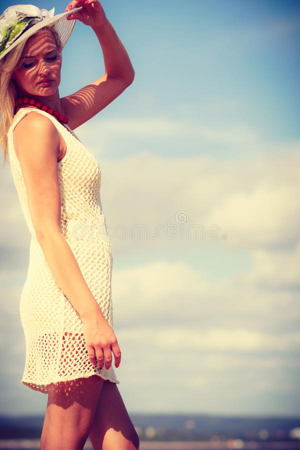 Attractive woman with white dress. Clothing, summer time concept. Attractive woman with white dress. Lady enjoying sunny weather by the seaside stock photography