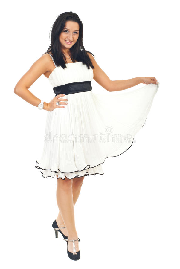 Attractive woman in white elegant dress stock photo