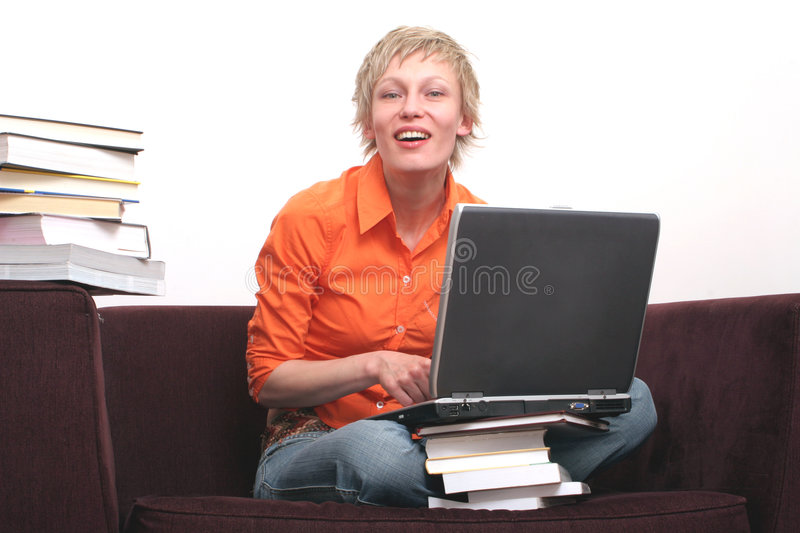 attractive woman working on laptop royalty free stock photography