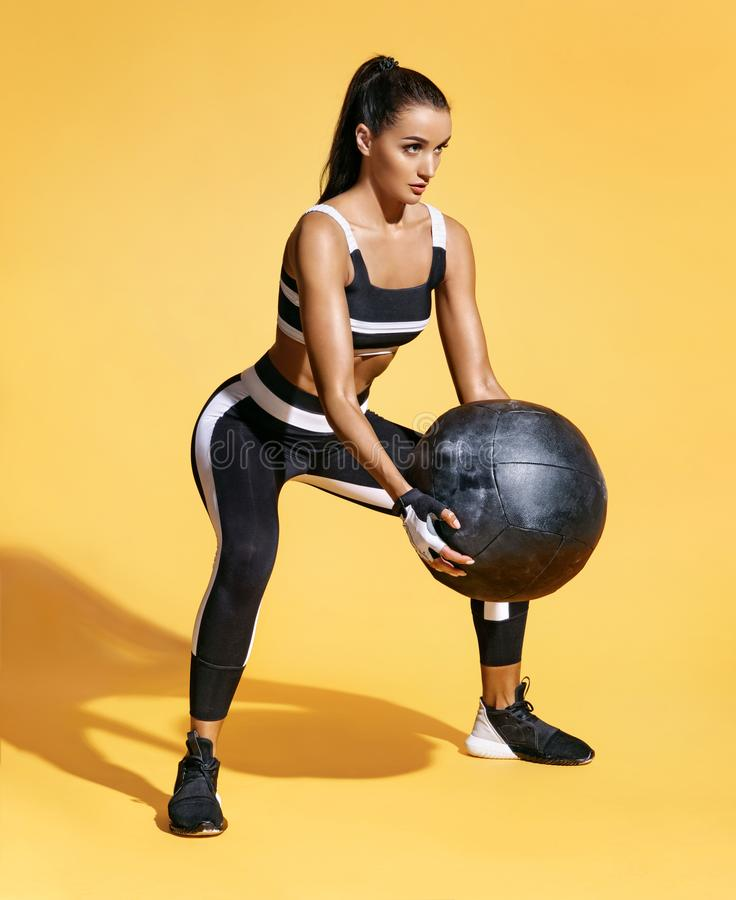 Attractive woman workout with med ball. royalty free stock images