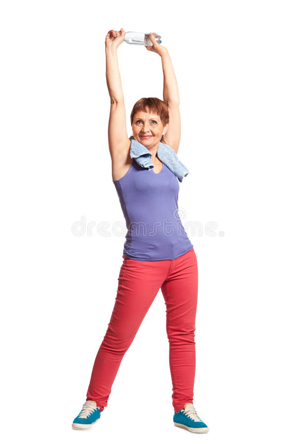 Attractive woman 50 years doing fitness royalty free stock image