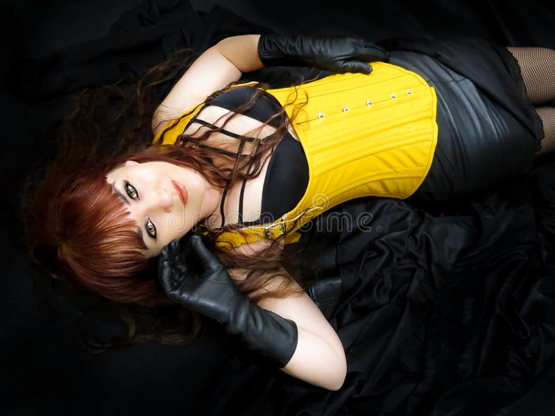 Attractive woman in yellow corset, viewed from above. stock images