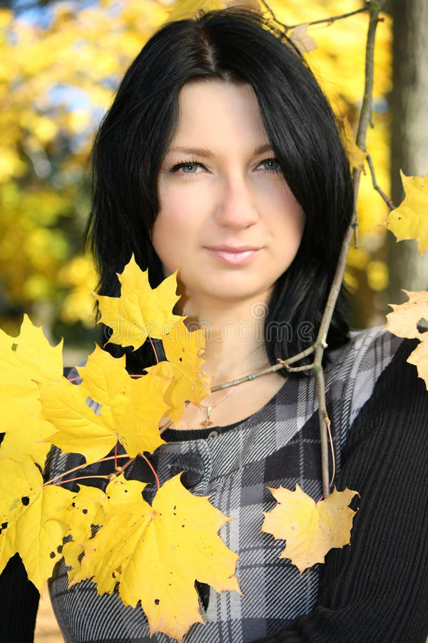 Download Attractive Woman With Yellow Leafage Stock Photo - Image: 16437376