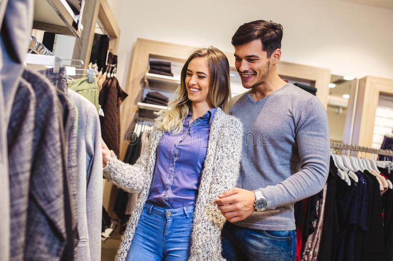 Attractive woman and young man go shopping at the store royalty free stock photos