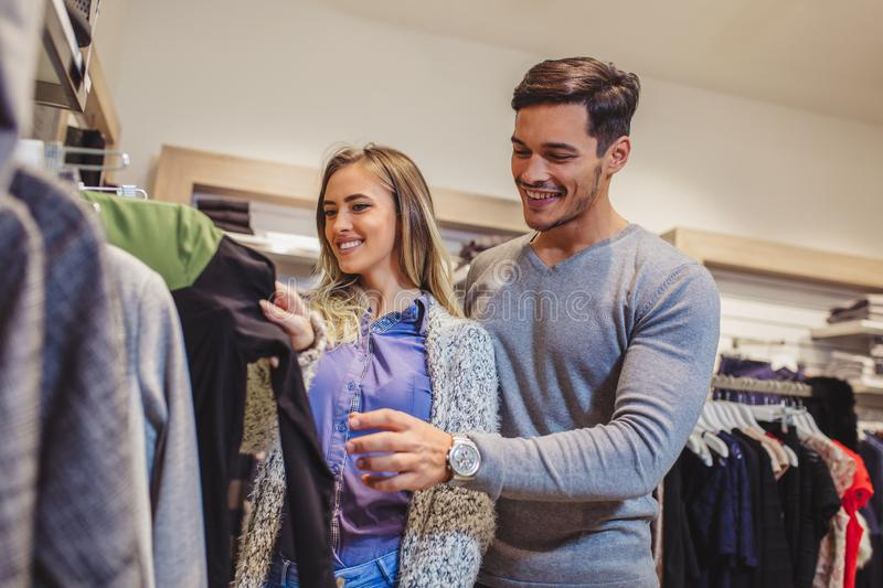 Attractive woman and young man go shopping stock image