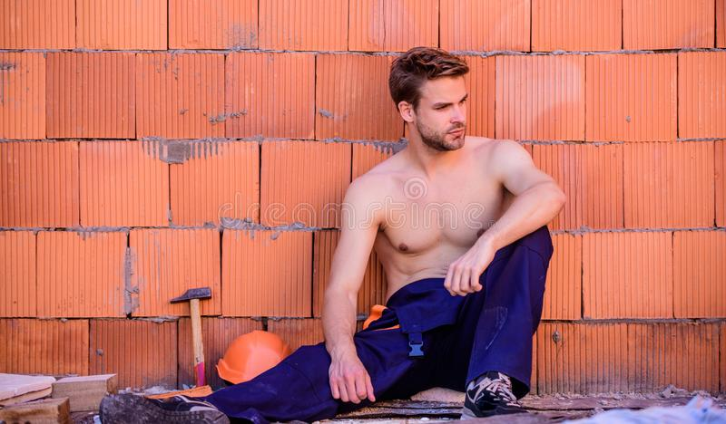 Attractive worker. Handsome sexy laborer. Inspecting building. Building construction. General maintenance repair worker stock image