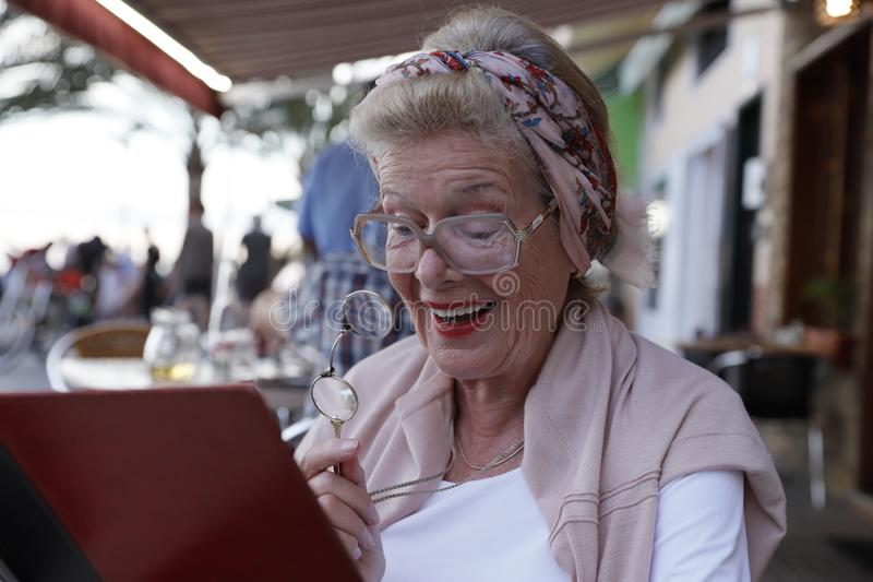 Attractive grandma in a restaurant. royalty free stock image