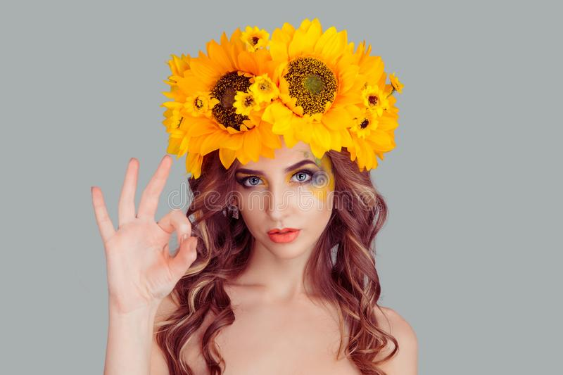 Woman with floral headband showing ok sign. Attractive young adult Woman with floral headband showing ok sign. Expression emotion and feelings concept. Studio stock images
