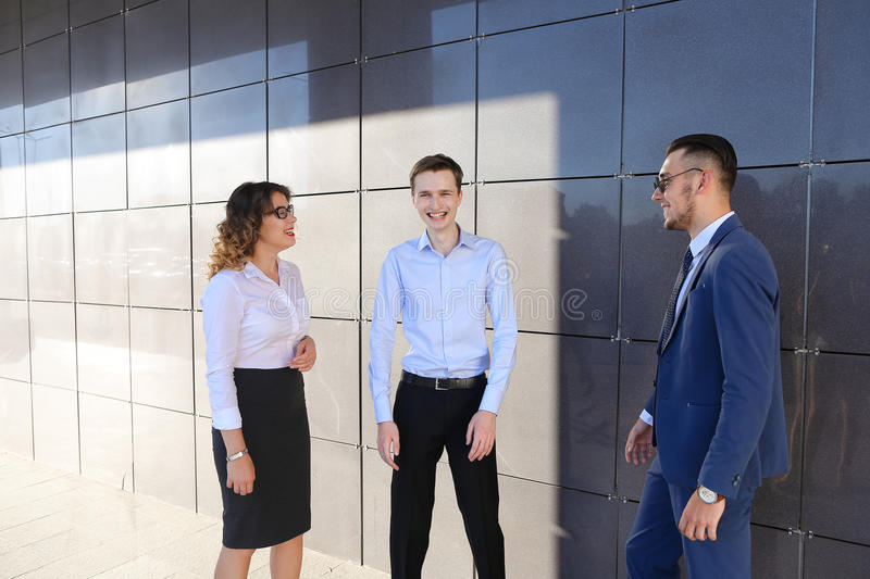 Attractive young adults businessmen, students met up and discuss. Energetic beautiful young guys and girl, businessmen and students to meet and discuss important stock photography