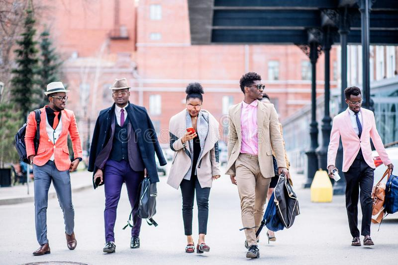 Attractive young african people are hurring to catch their train stock image