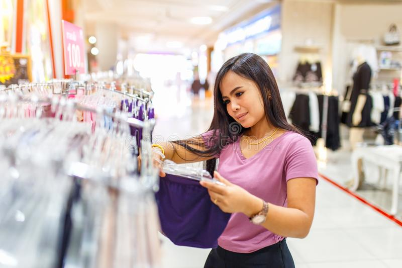 Attractive young asian woman shopping for underwear in clothing store stock photos