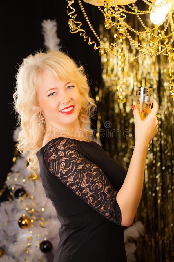 Attractive young blonde girl on a holiday background. New Year concept. stock photography