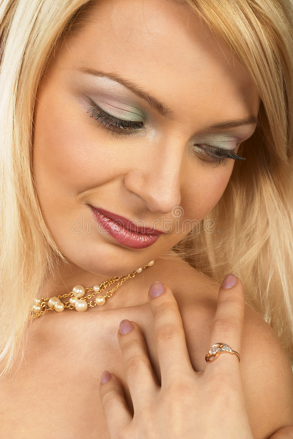 Attractive young blonde woman. Close-up. stock photos