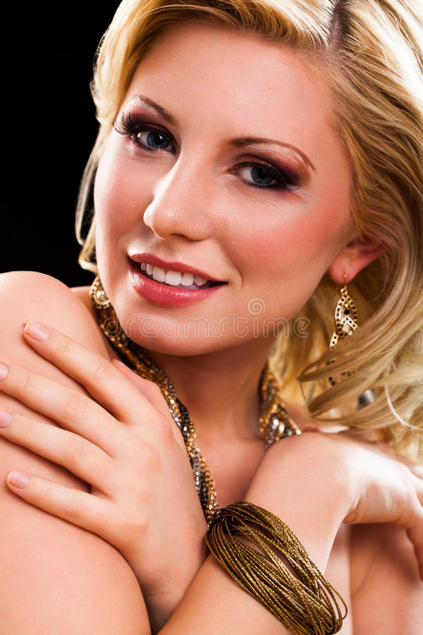 Attractive young blonde woman with glamorous look royalty free stock photo