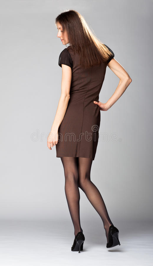 Attractive young brunette; full length portrait stock photography