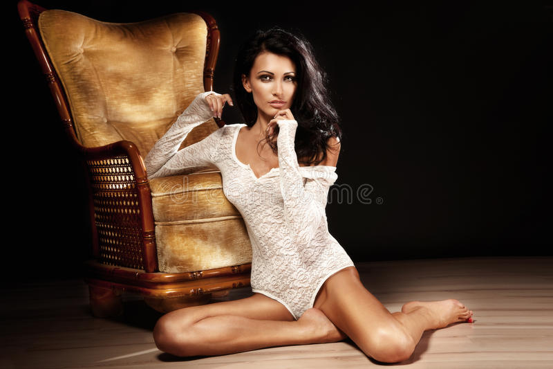 Download Attractive Young Brunette Woman Sitting On The Floor Stock Photo - Image of hair, lady: 29483330
