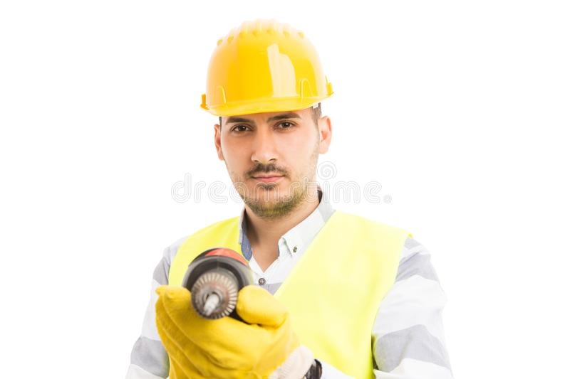 Attractive young builder or constructor holding drilling machine stock image