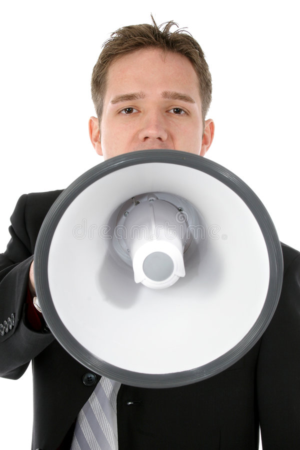 Attractive Young Business Man with Bullhorn. Attractive twenty something business man in suit. Yelling into bullhorn royalty free stock images
