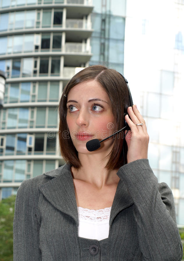 Attractive young businesswoman with headset stock photos