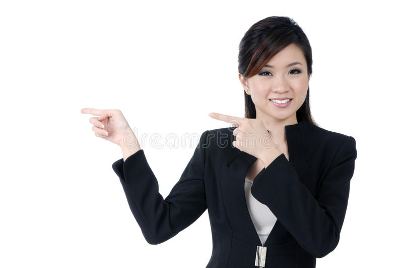 Attractive young businesswoman pointing royalty free stock photos