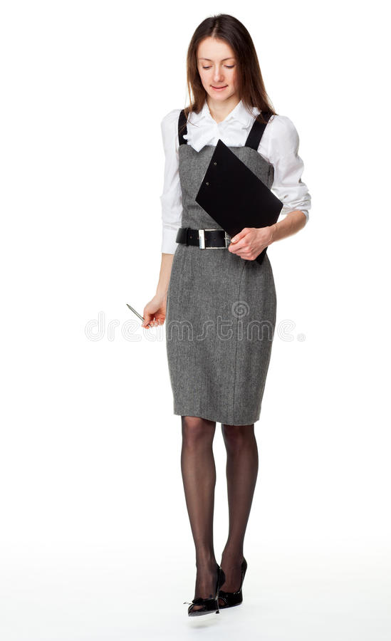 Attractive young businesswoman walking stock photography