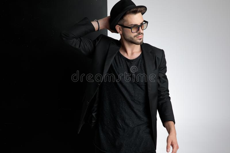 Attractive young casual man wearing hat and sunglasses royalty free stock photography